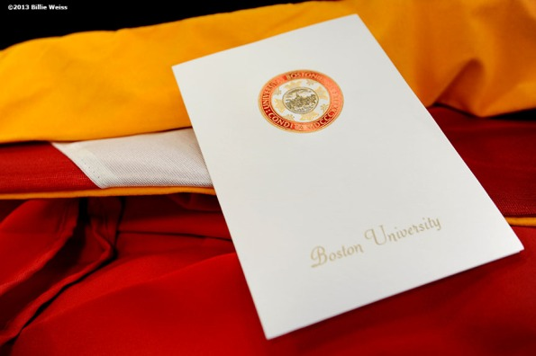 """An invitation to the 140th Commencement at Boston University is displayed Friday, May 17, 2013 in Boston, Massachusetts."""