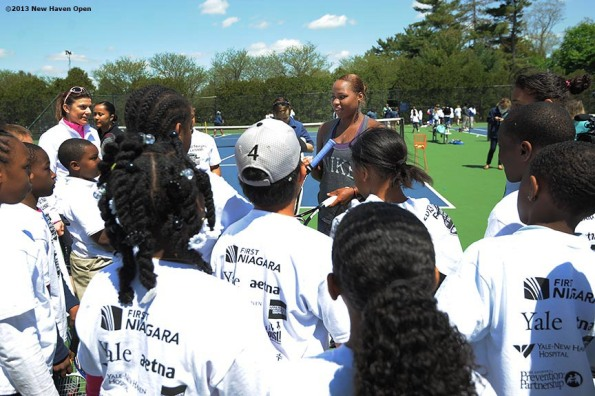 """Professional Tennis Player Taylor Townsend talks to kids Monday, May 13, 2013 at a free tennis lesson promotional event leading up to the New Haven Open Tennis Tournament at Yale University in New Haven, Connecticut. Over three hundred children from ten New Haven public schools attended the event."""