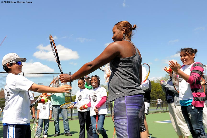 """Professional Tennis Player Taylor Townsend leads a tennis drill Monday, May 13, 2013 at a free tennis lesson promotional event leading up to the New Haven Open Tennis Tournament at Yale University in New Haven, Connecticut. Over three hundred children from ten New Haven public schools attended the event."""