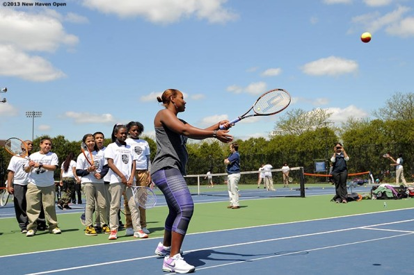 """Professional Tennis Player Taylor Townsend leads a volley drill Monday, May 13, 2013 at a free tennis lesson promotional event leading up to the New Haven Open Tennis Tournament at Yale University in New Haven, Connecticut."""