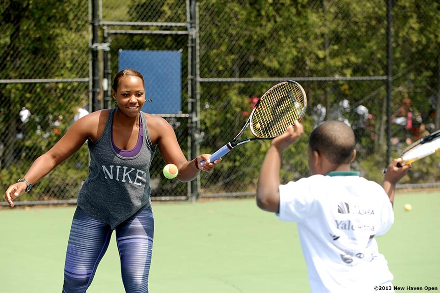 """Professional Tennis Player Taylor Townsend leads a volley drill Monday, May 13, 2013 at a free tennis lesson promotional event leading up to the New Haven Open Tennis Tournament at Yale University in New Haven, Connecticut. Over three hundred children from ten New Haven public schools attended the event."""