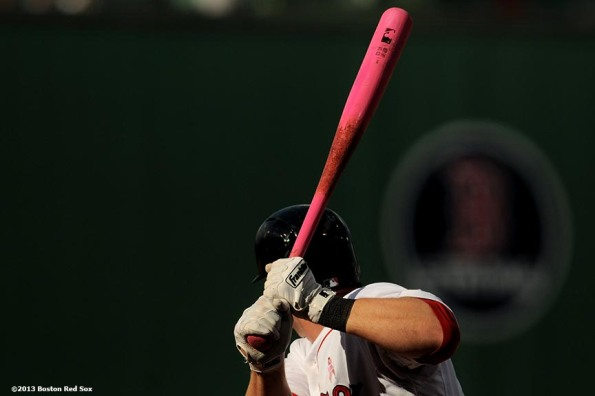 """Boston Red Sox shortstop Stephen Drew bats with a pink bat in honor of Mother's Day during the ninth inning of a game against the Toronto Blue Jays Sunday, May 12, 2013 at Fenway Park in Boston, Massachusetts."""