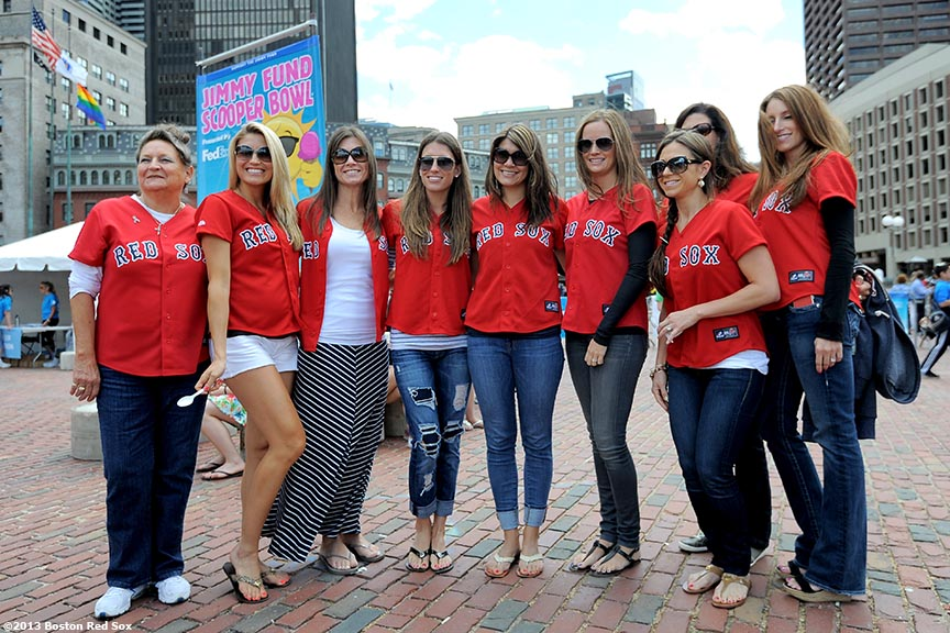 """Boston Red Sox wives pose for a photograph during the 31st annual Jimmy Fund Scooper Bowl, the nation's largest all-you-can eat ice cream festival, at City Hall Plaza in Boston, Massachusetts Tuesday, June 4, 2013. The event has raised over three million dollars for cancer research and care."""