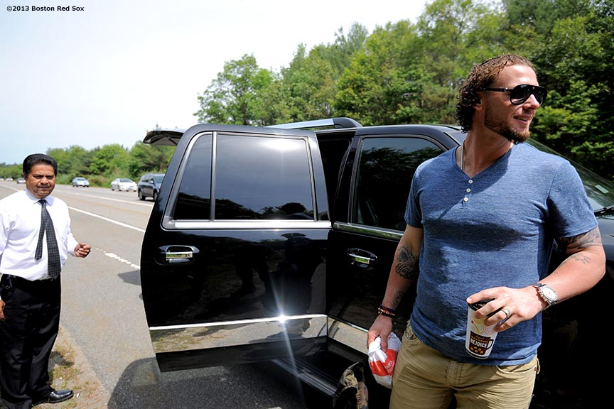 """Boston Red Sox catcher Jarrod Saltalamacchia laughs as he gets into a second vehicle after the first was forced to pull over due to a flat tire on Route 3 in Massachusetts Thursday, June 6, 2013."""