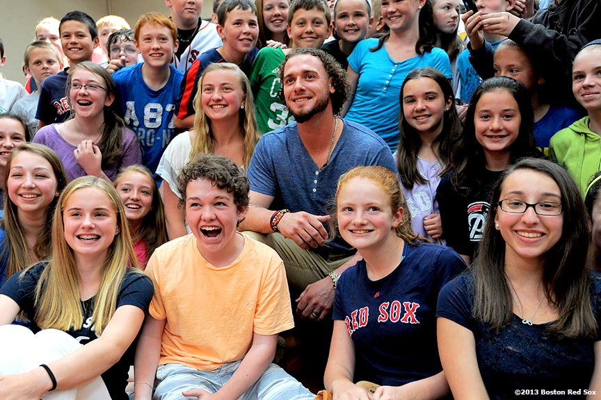 """Boston Red Sox catcher Jarrod Saltalamacchia poses for a photograph with students at Furnace Brook Middle School in Marshfield, Massachusetts Thursday, June 6, 2013 as part of the Rally Against Cancer Program, a collaborative effort between the Red Sox and the Jimmy Fund to raise money for cancer research and care."""