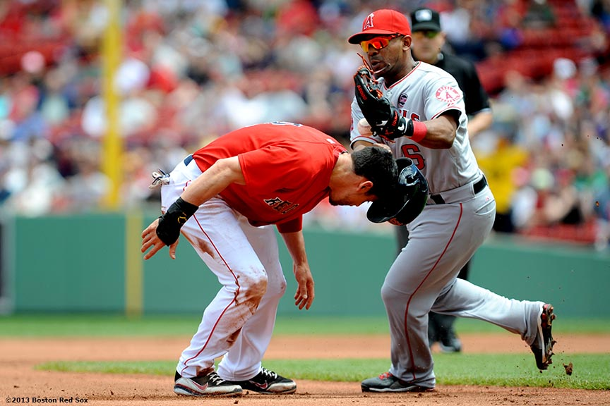 """Boston Red Sox centerfielder Jacoby Ellsbury is tagged out in a rundown by third baseman Alberto Callaspo during the first inning of a game against the Los Angeles Angels of Anaheim Saturday, June 8, 2013 at Fenway Park in Boston, Massachusetts."""