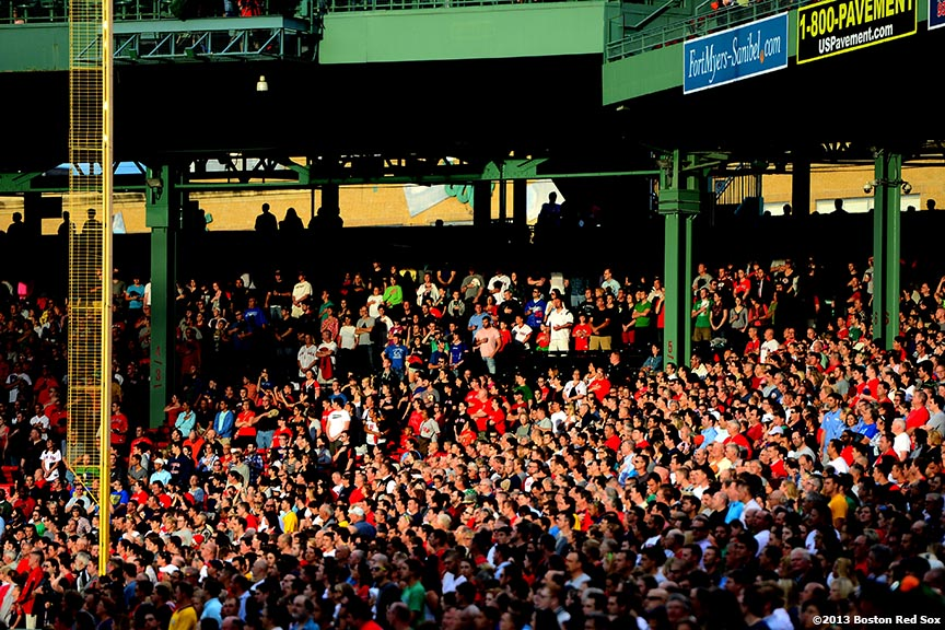 """Fans stand for the National Anthem before a game between the Boston Red Sox and the Los Angeles Angels of Anaheim Saturday, June 8, 2013 at Fenway Park in Boston, Massachusetts."""