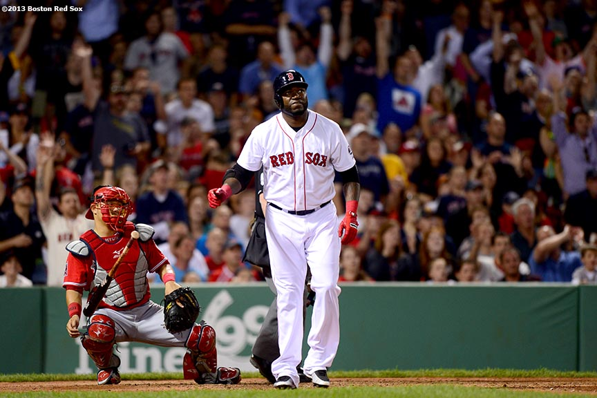 """Boston Red Sox designated hitter David Ortiz hits a two run home run during the sixth inning of a game against the Los Angeles Angels of Anaheim Saturday, June 8, 2013 at Fenway Park in Boston, Massachusetts."""