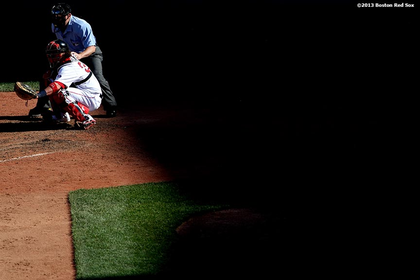 """""""Boston Red Sox catcher Jarrod Saltalamacchia catches during the ninth inning of a game against the Los Angeles Angels of Anaheim Sunday, June 9, 2013 at Fenway Park in Boston, Massachusetts."""""""