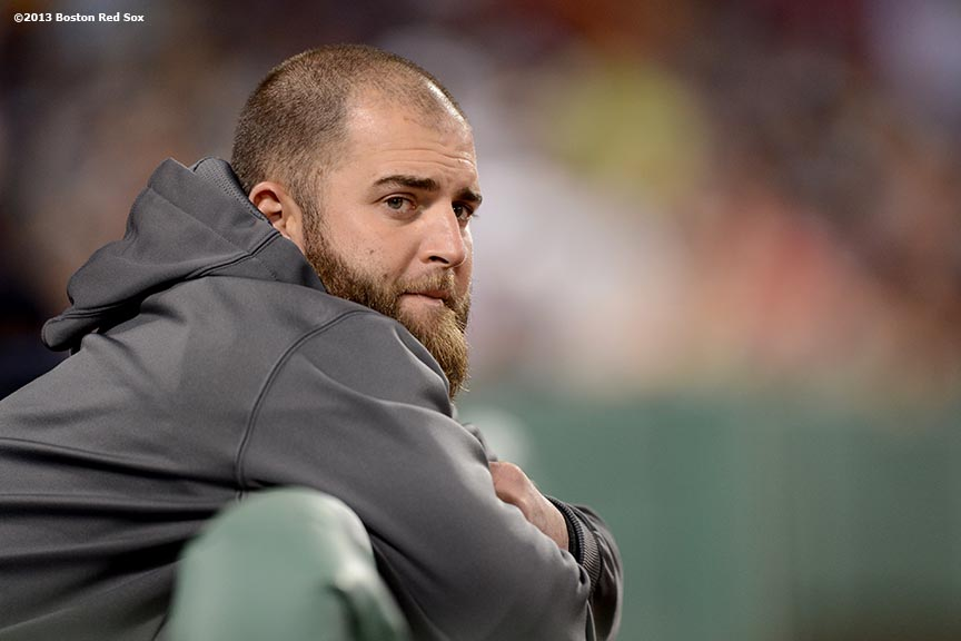 """Boston Red Sox first baseman Mike Napoli looks on from the dugout during the sixth inning of a game against the Tampa Bay Rays Tuesday, June 18, 2013 at Fenway Park in Boston, Massachusetts."""