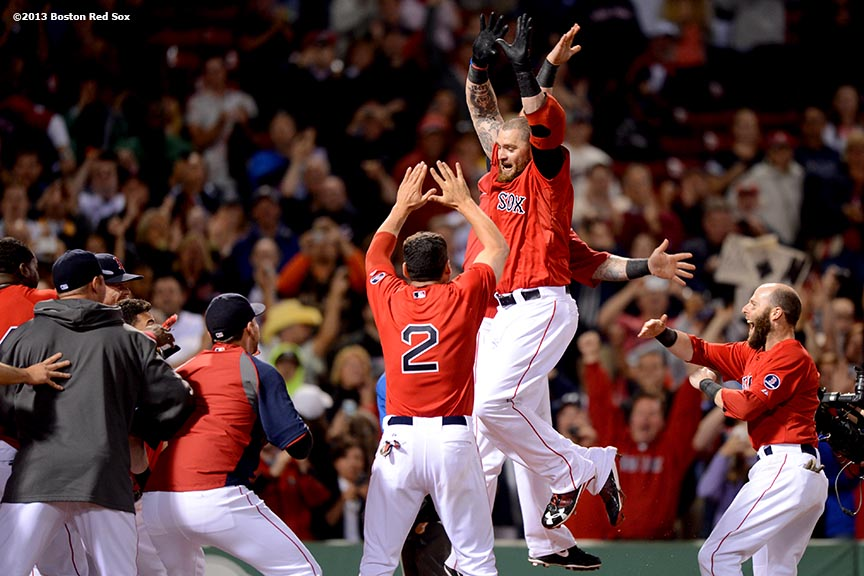 """Boston Red Sox outfielder Jonny Gomes celebrates after hitting a walk-off two-run home run in the bottom of the ninth inning to defeat the Tampa Bay Rays 3-1 Tuesday, June 18, 2013 at Fenway Park in Boston, Massachusetts."""