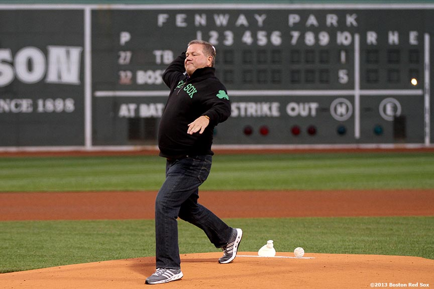 """Brian Kelly, Head Coach of the University of Notre Dame football team, throws out the ceremonial first pitch before a game between the Boston Red Sox and the Tampa Bay Rays Tuesday, June 18, 2013 at Fenway Park in Boston, Massachusetts."""
