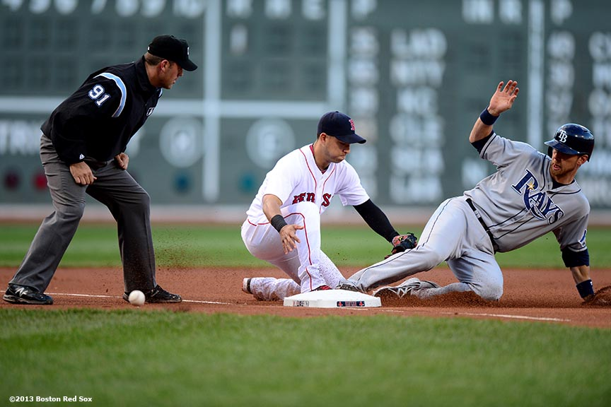 """Boston Red Sox third baseman Jose Iglesias applies a tag during the first inning of a game against the Tampa Bay Rays Wednesday, June 19, 2013 in Boston, Massachusetts."""
