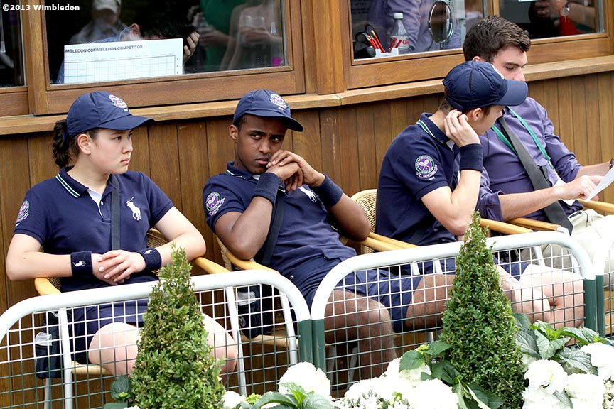 """Ball kids sit outside the referee's office at the All England Lawn and Tennis Club in London, England Wednesday, June 26, 2013 during the 2013 Championships Wimbledon."""