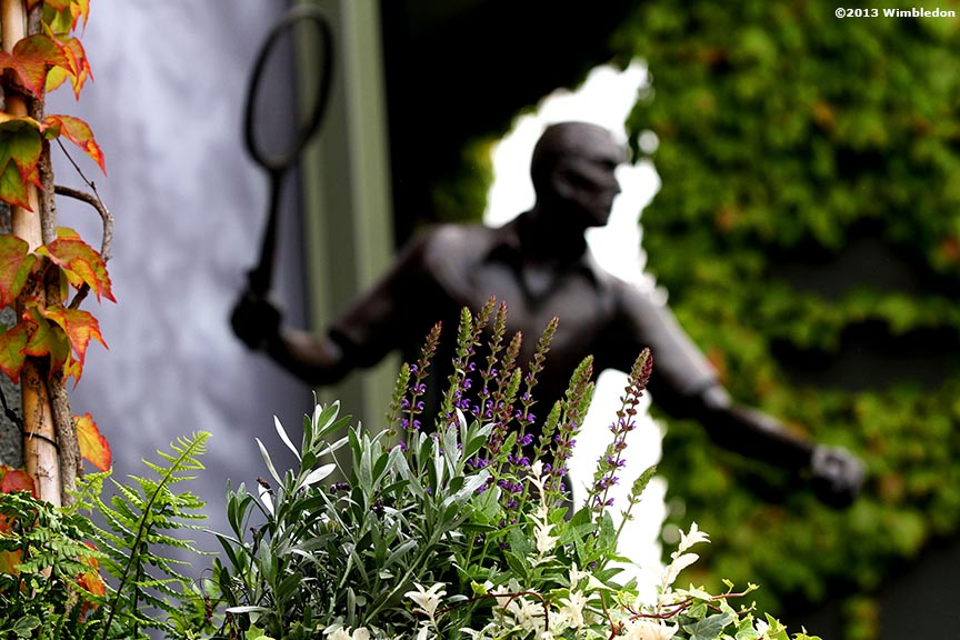 """A statue of past Wimbledon Champion Fred Perry is shown at the All England Lawn and Tennis Club in London, England Wednesday, June 26, 2013 during the 2013 Championships Wimbledon."""