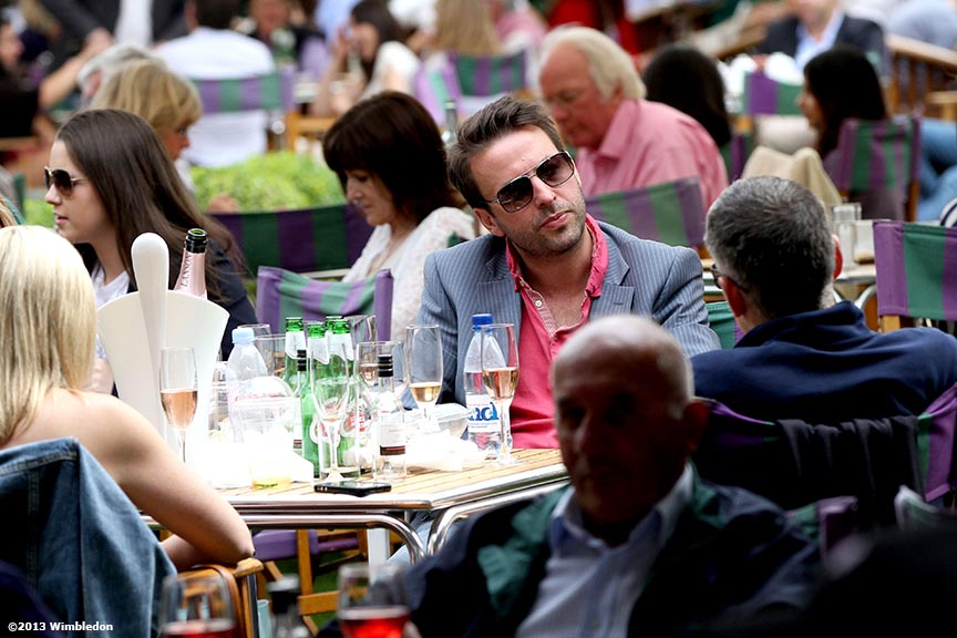 """Guests talk over a drink at the All England Lawn and Tennis Club in London, England Wednesday, June 26, 2013 during the 2013 Championships Wimbledon."""