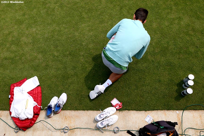 """Novak Djokovic ties his shoes on the Aorangi Practice Courts at the All England Lawn and Tennis Club in London, England Wednesday, June 26, 2013 during the 2013 Championships Wimbledon."""