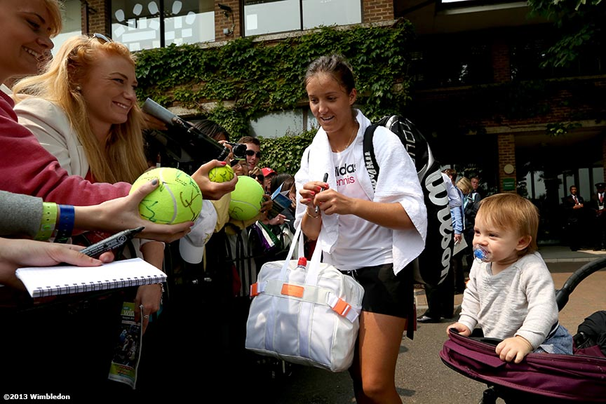 """Laura Robson signs autographs for fans at the All England Lawn and Tennis Club in London, England Wednesday, June 26, 2013 during the 2013 Championships Wimbledon."""