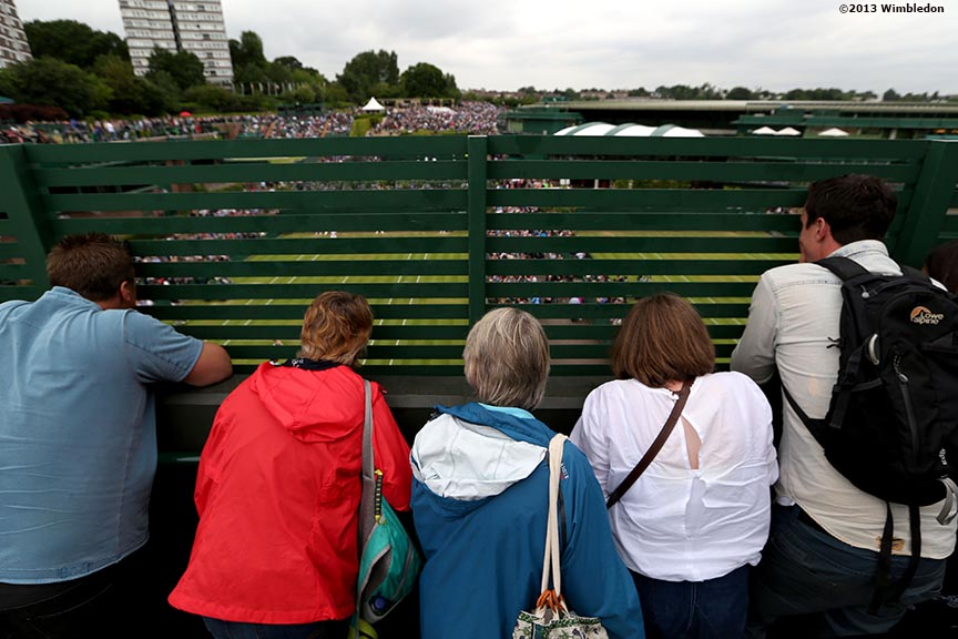 """Fans crowd together to get a view of No. 14 Court at the All England Lawn and Tennis Club in London, England Friday, June 28, 2013 during the 2013 Championships Wimbledon."""