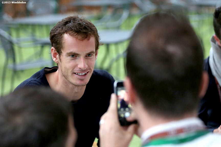 """Andy Murray answers questions for a social media promotion on the players lawn at the All England Lawn and Tennis Club in London, England Friday, June 27, 2013 during the 2013 Championships Wimbledon."""