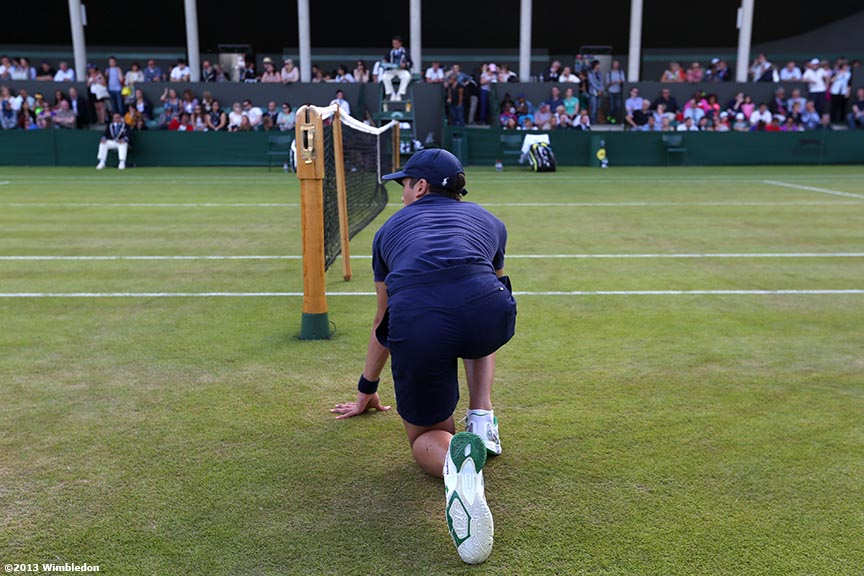 """A ball boy kneels during a point at the All England Lawn and Tennis Club in London, England Wimbledon, June 29, 2013 during the 2013 Championships Wimbledon."""