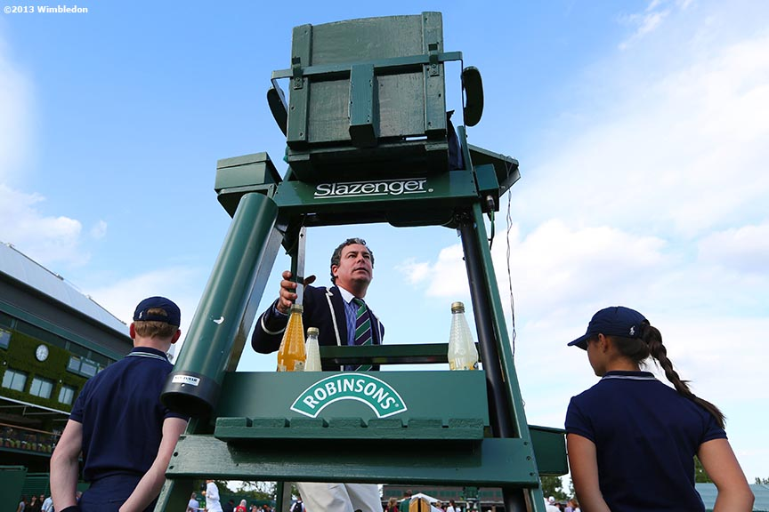 """A chair umpire climbs up to his seat at the All England Lawn and Tennis Club in London, England Wimbledon, June 29, 2013 during the 2013 Championships Wimbledon."""