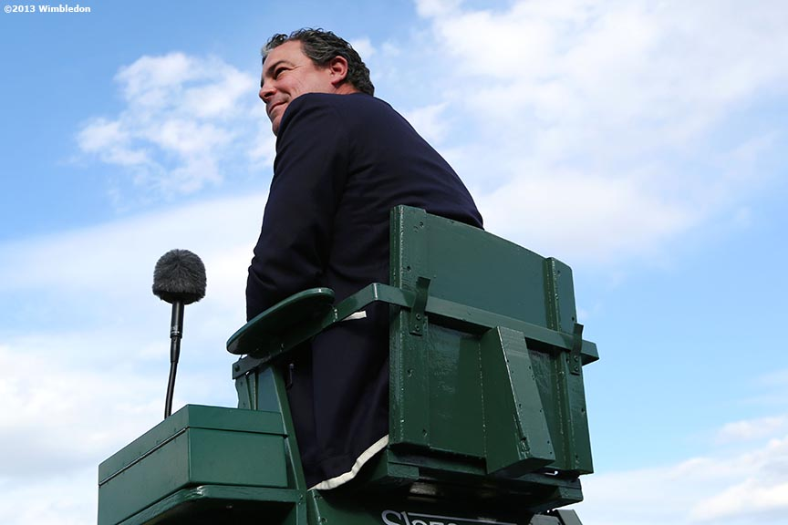 """A chair umpire looks on during a match at the All England Lawn and Tennis Club in London, England Wimbledon, June 29, 2013 during the 2013 Championships Wimbledon."""