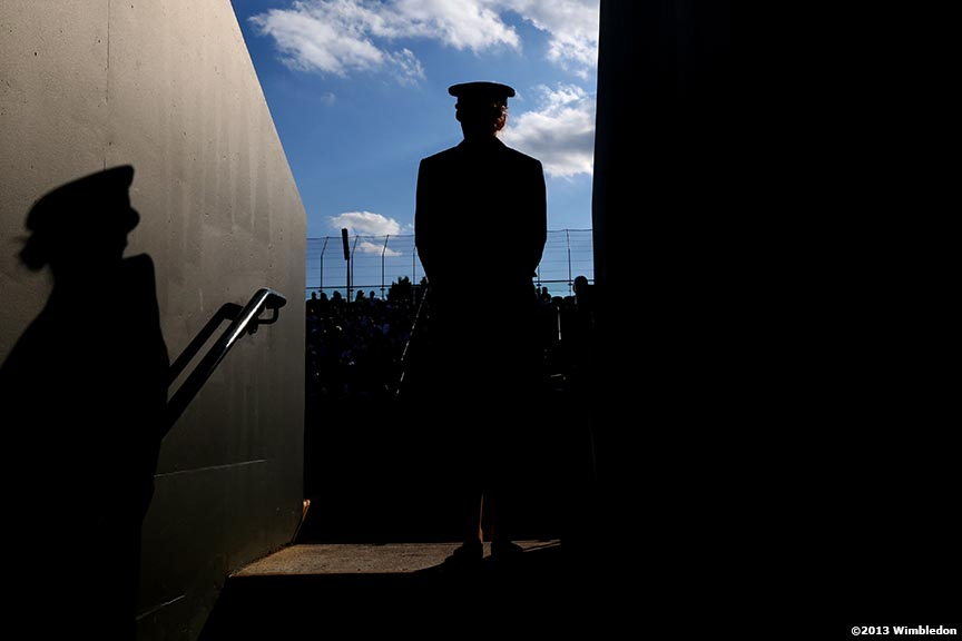 """A guard stands in an entranceway to No. 5 at the All England Lawn and Tennis Club in London, England Wimbledon, June 29, 2013 during the 2013 Championships Wimbledon."""