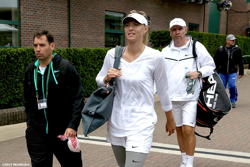 """Maria Sharapova leaves the practice courts at the All England Lawn and Tennis Club in London, England Saturday, June 22, 2013 before the start of the 2013 Championships Wimbledon."""