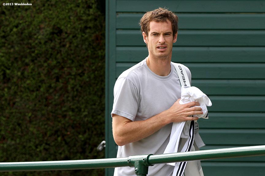"""Andy Murray walks toward the practice courts at the All England Lawn and Tennis Club in London, England Wimbledon, June 29, 2013 during the 2013 Championships Wimbledon."""
