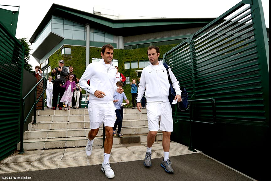 """Roger Federer walks toward the outer courts before a practice session at the All England Lawn and Tennis Club in London, England Saturday, June 22, 2013 before the start of the 2013 Championships Wimbledon."""