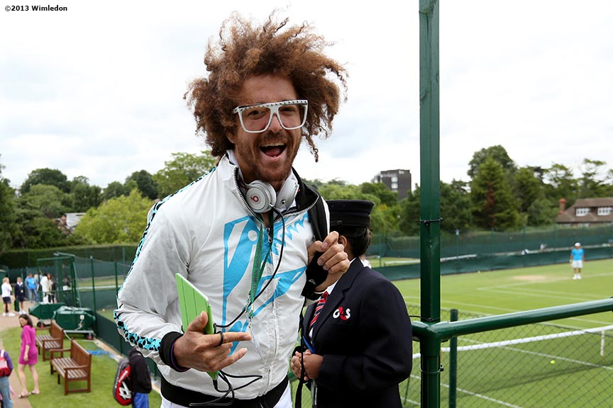 """Singer RedFoo of LMFAO has a laugh at the All England Lawn and Tennis Club in London, England Monday, June 24, 2013 during the 2013 Championships Wimbledon."""