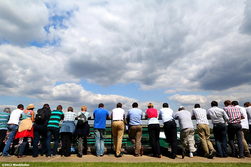 """Spectators watch a match on No. 17 Court at the All England Lawn and Tennis Club in London, England Tuesday, June 25, 2013 during the 2013 Championships Wimbledon."""