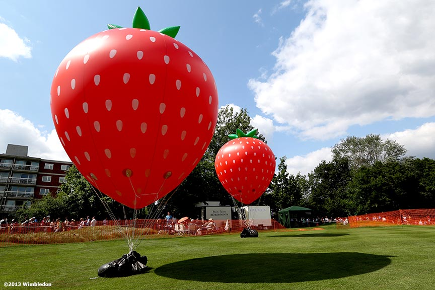 """Inflatable Strawberries are shown at the All England Lawn and Tennis Club in London, England Tuesday, June 25, 2013 during the 2013 Championships Wimbledon."""