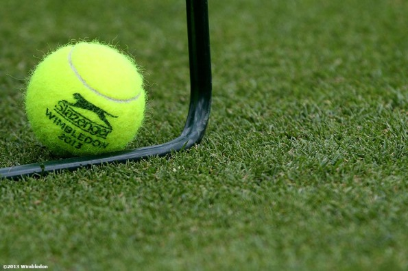 """An official Slazenger tennis ball is shown at the All England Lawn and Tennis Club in London, England Saturday, June 22, 2013 before the start of the 2013 Championships Wimbledon."""