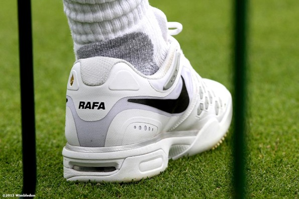 """The left shoe of Rafael Nadal is shown at the All England Lawn and Tennis Club in London, England Saturday, June 22, 2013 before the start of the 2013 Championships Wimbledon."""