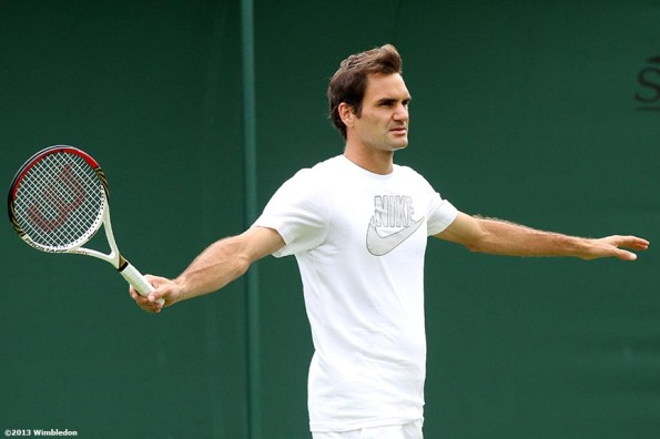 """Roger Federer gestures during a practice session at the All England Lawn and Tennis Club in London, England Saturday, June 22, 2013 before the start of the 2013 Championships Wimbledon."""