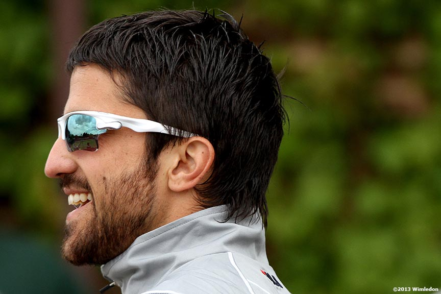 """Janko Tipsarevic laughs at the All England Lawn and Tennis Club in London, England Monday, June 24, 2013 during the 2013 Championships Wimbledon."""