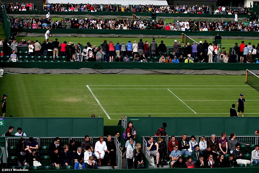 """Fans take in action on the outer courts at the All England Lawn and Tennis Club in London, England Monday, June 24, 2013 during the 2013 Championships Wimbledon."""