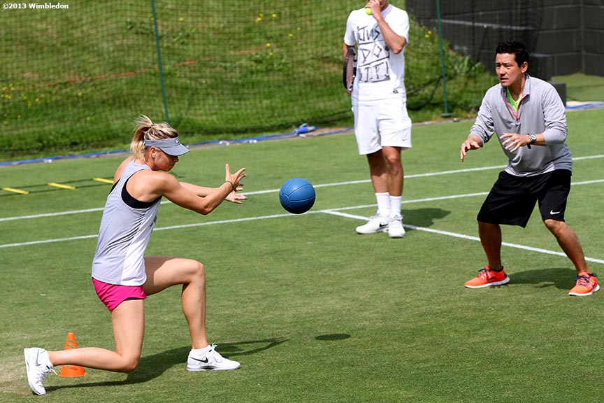 """Maria Sharapova throws a medicine ball at the All England Lawn and Tennis Club in London, England Tuesday, June 25, 2013 during the 2013 Championships Wimbledon."""