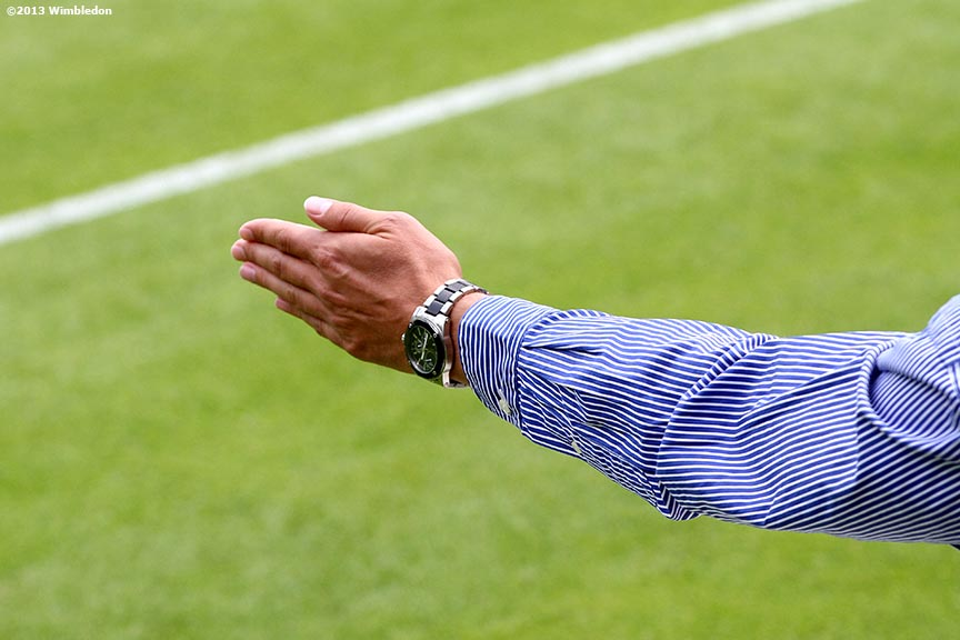 """A line judge gestures a call at the All England Lawn and Tennis Club in London, England Tuesday, June 25, 2013 during the 2013 Championships Wimbledon."""