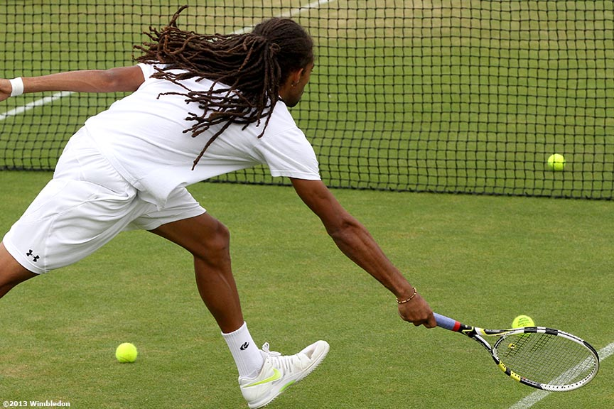 """Dustin Brown reaches for a volley during a practice session at the All England Lawn and Tennis Club in London, England Thursday, June 27, 2013 during the 2013 Championships Wimbledon."""