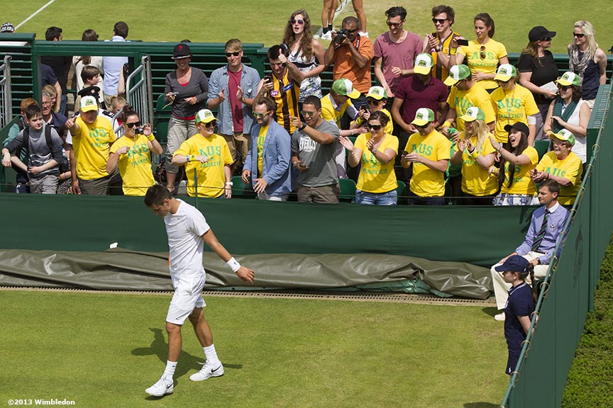 """Australian supporters cheer on Bernard Tomic after defeating James Blake at the All England Lawn and Tennis Club in London, England Thursday, June 27, 2013 during the 2013 Championships Wimbledon."""