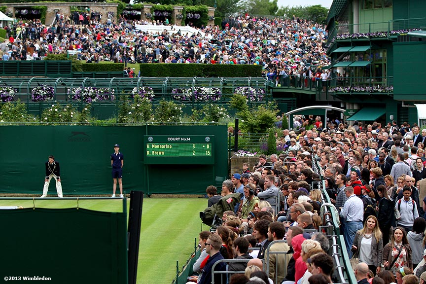 """Fans crowd No. 14 Court and Henman Hill at the All England Lawn and Tennis Club in London, England Friday, June 28, 2013 during the 2013 Championships Wimbledon."""