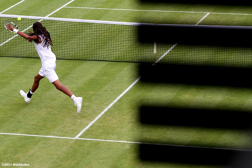 """Dustin Brown lunges for a volley at the All England Lawn and Tennis Club in London, England Friday, June 28, 2013 during the 2013 Championships Wimbledon."""