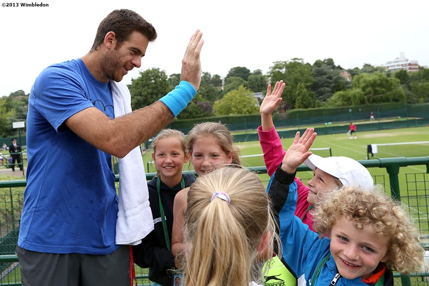 """Juan Martin Del Potro signs autographs for young fans at the All England Lawn and Tennis Club in London, England Tuesday, July 2, 2013 during the 2013 Championships Wimbledon."""