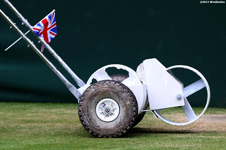 """A line painting machine is shown at the All England Lawn and Tennis Club in London, England Tuesday, July 2, 2013 during the 2013 Championships Wimbledon."""