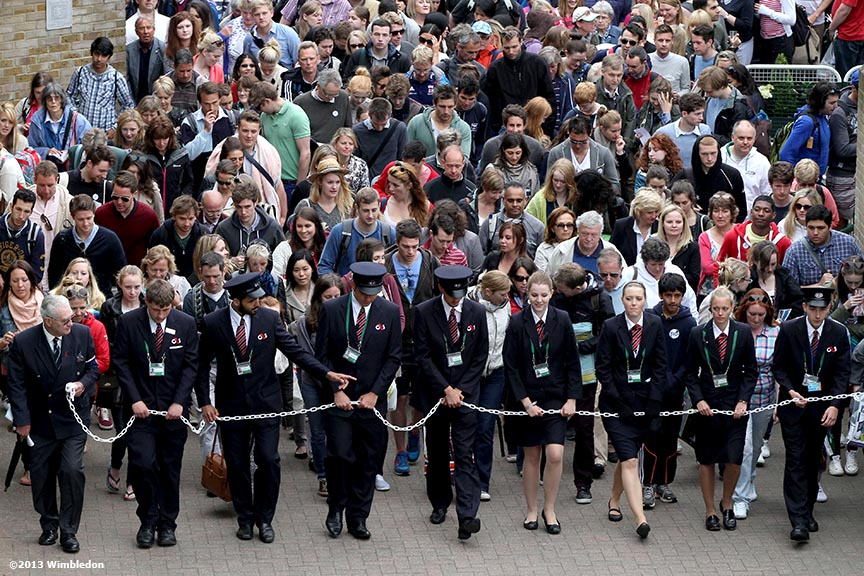 """""""Stewards lead fans into the grounds at the All England Lawn and Tennis Club in London, England Tuesday, July 2, 2013 during the 2013 Championships Wimbledon."""""""