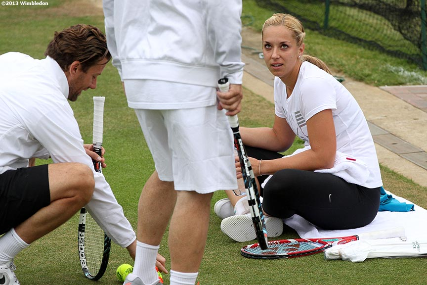 """Sabine Lisicki talk with her coach during a practice session at the All England Lawn and Tennis Club in London, England Tuesday, July 2, 2013 during the 2013 Championships Wimbledon."""