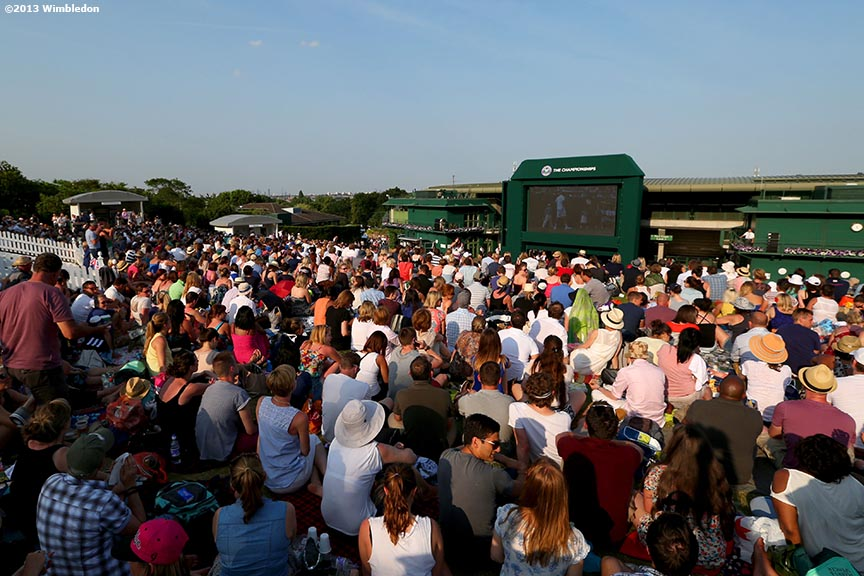 """Fans pack Henman Hill as they watch Andy Murray play Jerzy Janowicz in the Gentlemen's Semi-Final match at the All England Lawn and Tennis Club in London, England Tuesday, July 2, 2013 during the 2013 Championships Wimbledon."""
